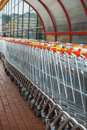 carts for purchase at the store. red food basket trolleys