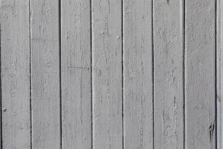 background fence of gray wooden boards.