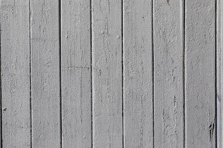 clôture de fond de planches de bois gris.