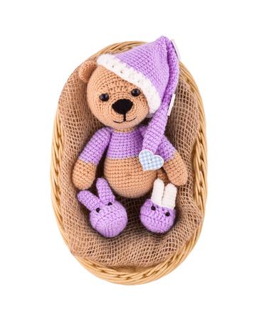 A Small Knitted Teddy Bear In A Wicker Basket A Sleepy Bear Stock