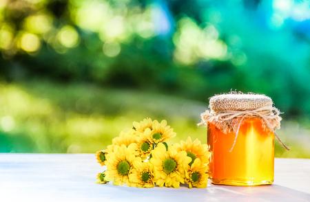 Natural organic honey and flowers. Grandmas gift. Wild honey. Spring concept. Natural medicine. Seasonal concept. Copy space