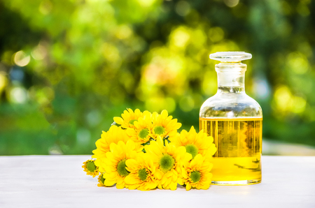 Essential oil. Spa concept. Flower elixir and fresh flowers. Natural cosmetic. Beauty concept. Stock Photo