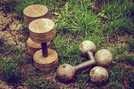 Old rusty dumbbells. Sport and health concept. Self-destruction concept Imagens - 109394638