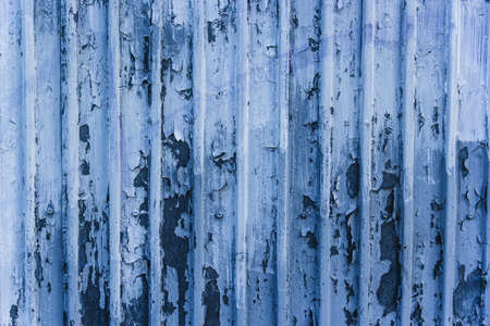 Metal blue wall with peeling paint