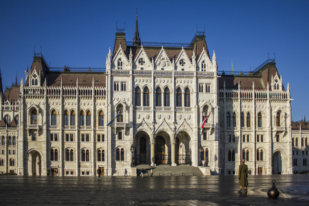 parliament of budapest with soldier standing guard