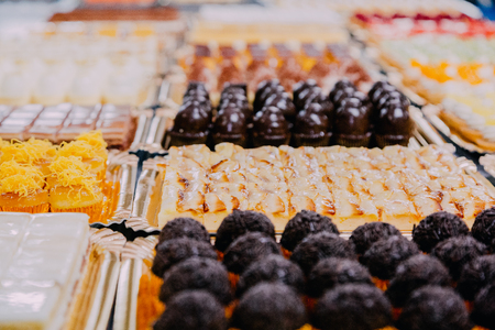 many different sweets prepared on the metal table of a food factory Reklamní fotografie