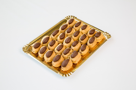 chocolate cupcakes in a gold tray on white background