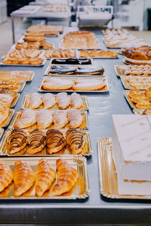 many different dishes prepared on the metal table of a food factory