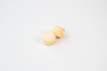 two white coconut vanilla macaroons with white background