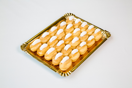 cupcakes in a gold tray on white background Reklamní fotografie