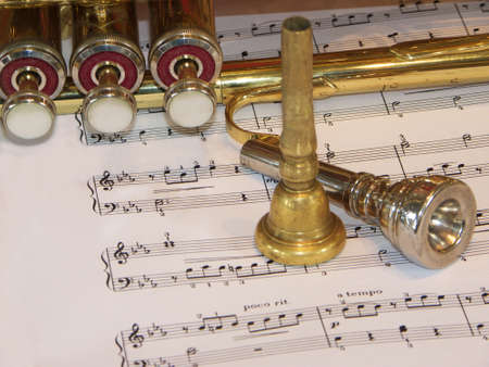 Two mouthpices and trumpet on a partiture