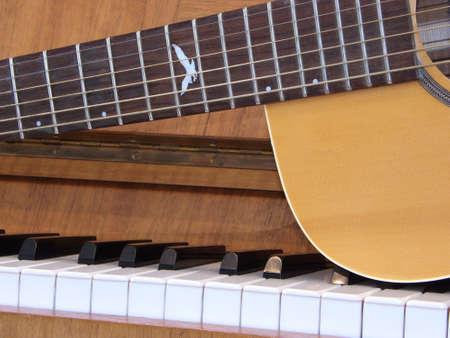 Guitar on piano keyboard Stock Photo