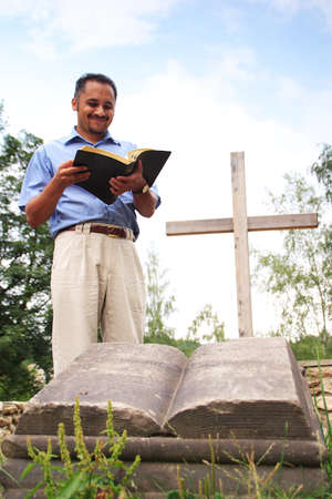 Young man reading from the Bible