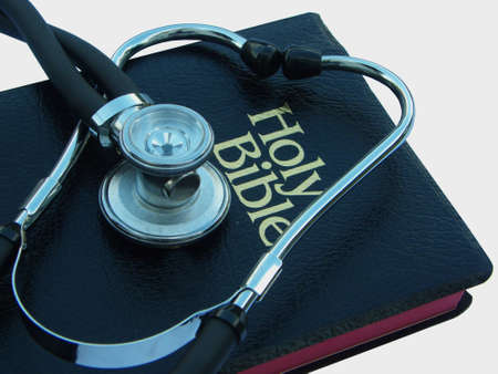 Stethoscope and Bible Stock Photo