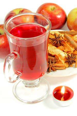 Red tea, apple, dried fruits, and candle photo