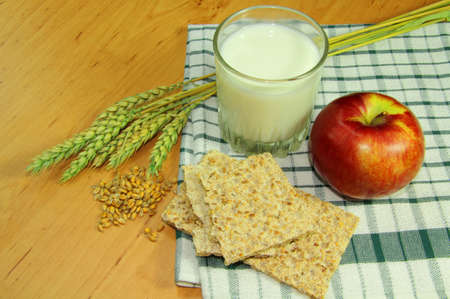 Milk, apple, sesame bread and wheat Stock Photo