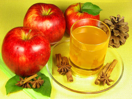 A cup of cider and apples