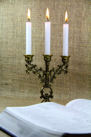 Candlestick and open Bible photo