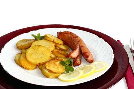 Grilled potatoes and sausages