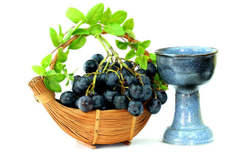 Grapes basket and old chalice