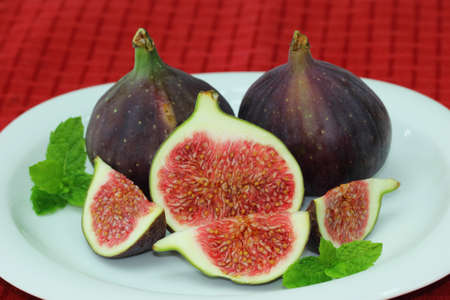 Fresh figs on white plate