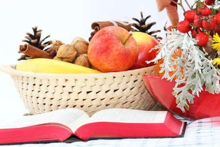 Open Bible and fruits basket photo