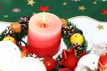 Candle and winter  decoration photo
