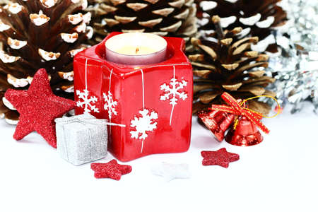 COnifers and red candles with stars Stock Photo