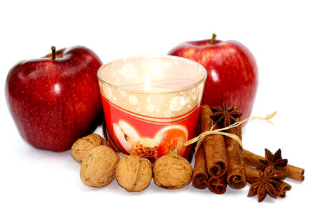 Apples nuts and cinnamon with candle Stock Photo