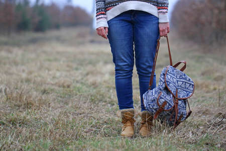 Young girl prepared for a trip in nature