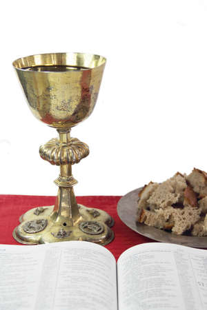 Gold chalice, bread and Bible