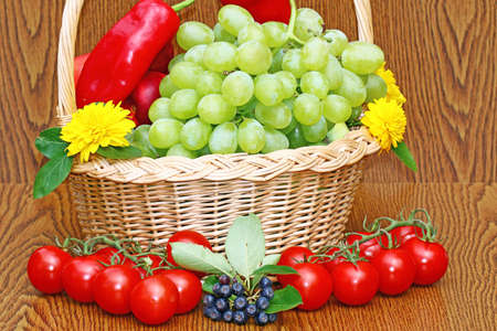 Grapes and fresh tomatoes Stock Photo