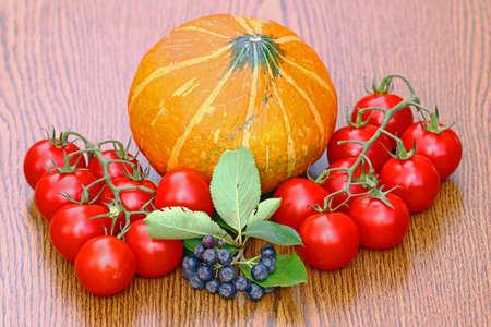 Pupkins and tomatoes Stock Photo