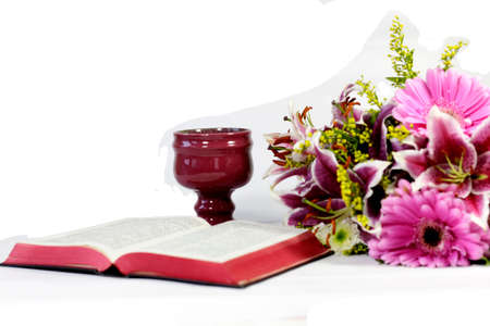 Open Bible, caliche and flowers on white background Stock fotó