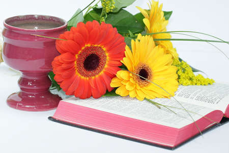 Christian symbols: chalice, flowers and open bible