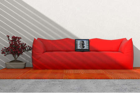 Sofa against the wall with computer