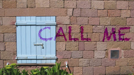 call me: Call me written on the wall