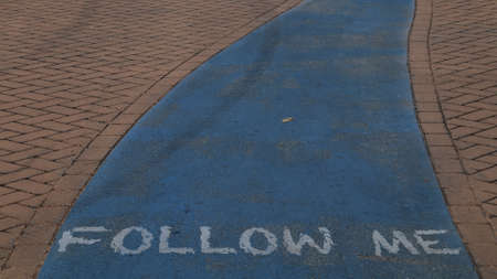 Follow me written on the bike path