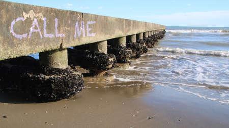 call me: Call me written on the beach Stock Photo