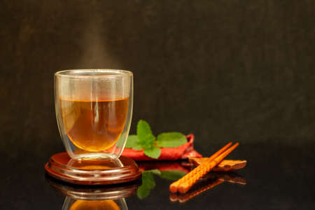 hot healthy drink Hot Tea clear Japanese tea in a glass elegant with chopsticks
