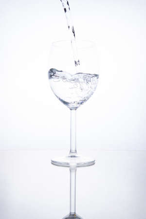 The glass is filled with clear transparent water. Banco de Imagens