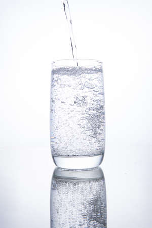 The glass beaker is filled with clear transparent mineral water. Banco de Imagens