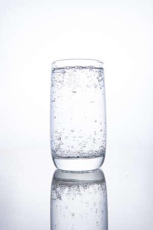 Full glass cup with carbonated pure mineral water