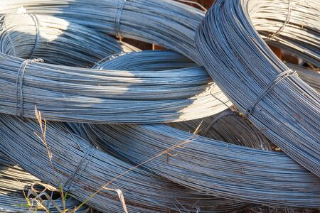 fencing wire: Rolls of stainless steel wire for use of fencing and industrial Stock Photo