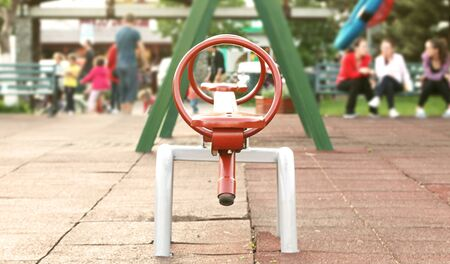 seesaw: Coloured seesaw on the playground