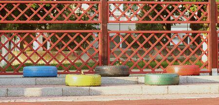 refurbished: Refurbished vehicle tires holding flowers Stock Photo
