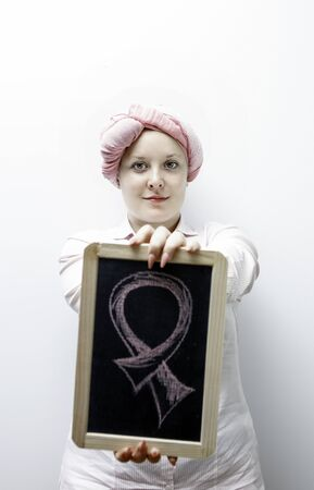 fighting cancer: Young women dressed in pink, fighting again breast cancer