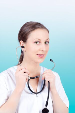 stethoscope: Close-up photo of female doctor holding stethoscope