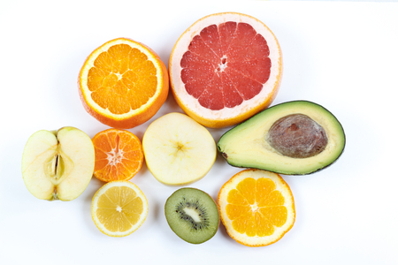 grouped: Various fruits grouped on a white background