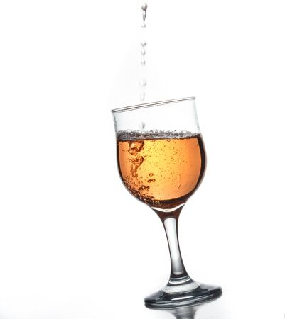 alcoholic beverage: Tilted glass of wine on a white background, sparkling alcoholic beverage